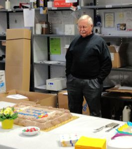 Hawk admiring his cake for his 30th anniversary gathering.